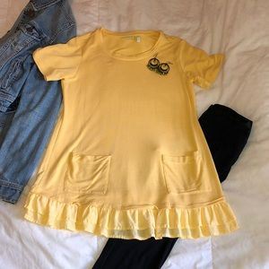 Pretty yellow long tunic top with front pockets
